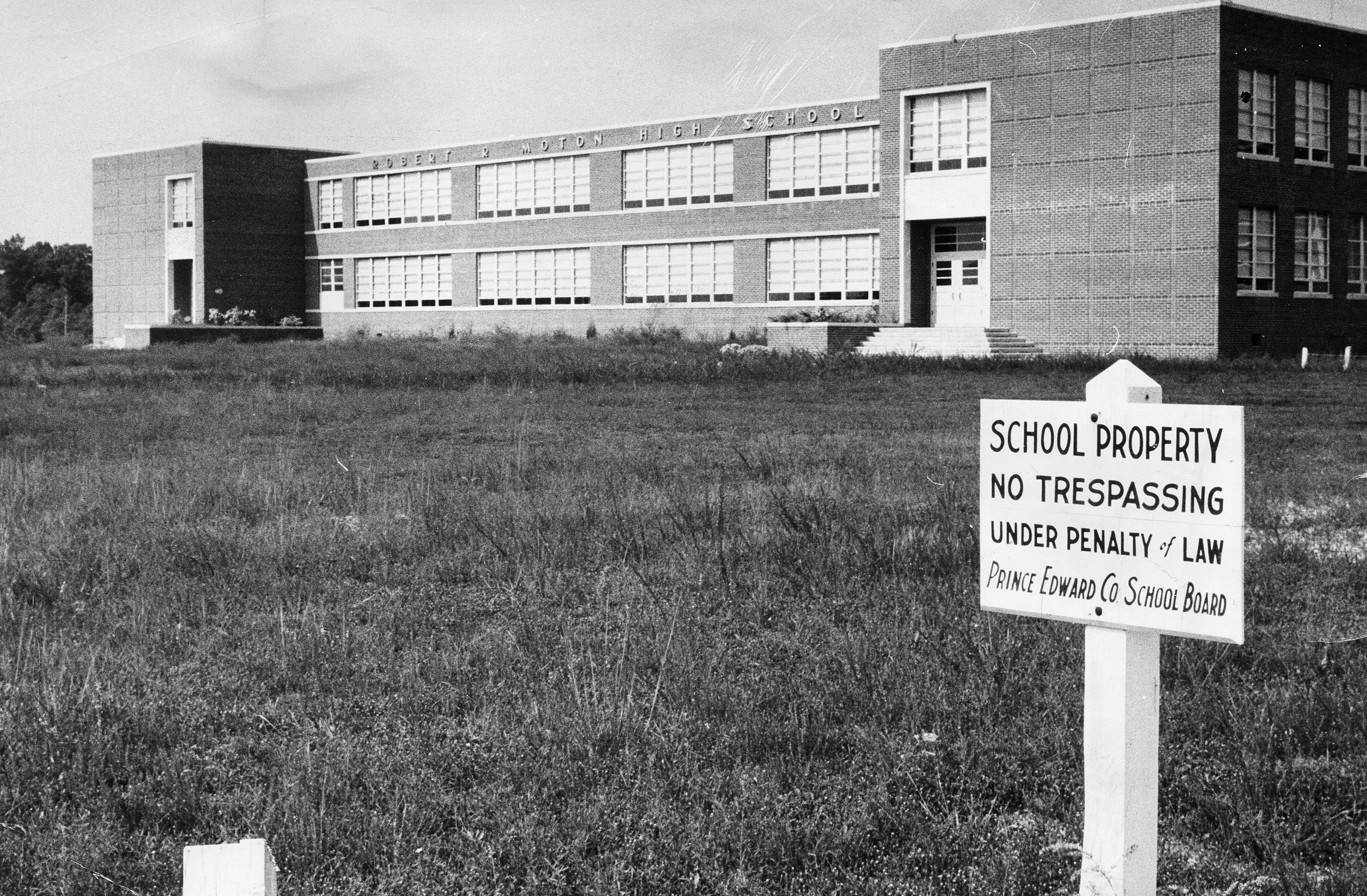 An image of a closed school with a no trespassing sign